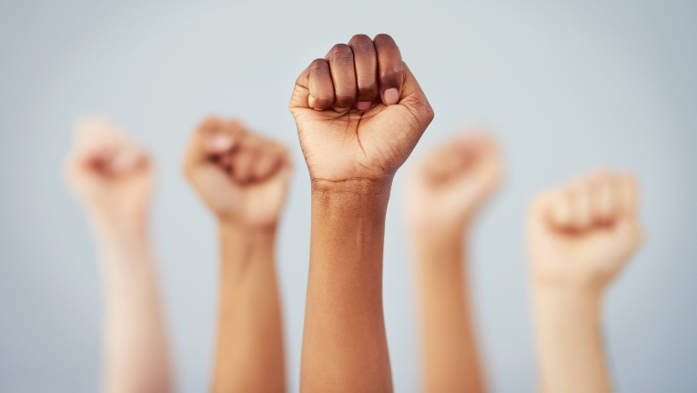 An array of fists raised as if in protest