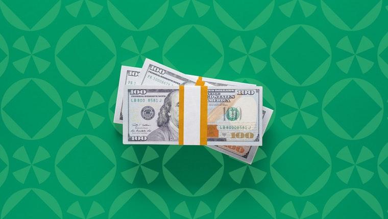 A bound stack of hundred-dollar bills.