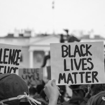 Image of Black Lives protestors with signs