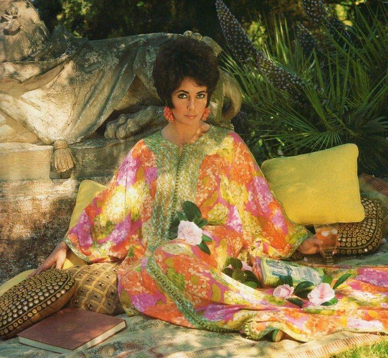 Liz Taylor wearing a floral caftan