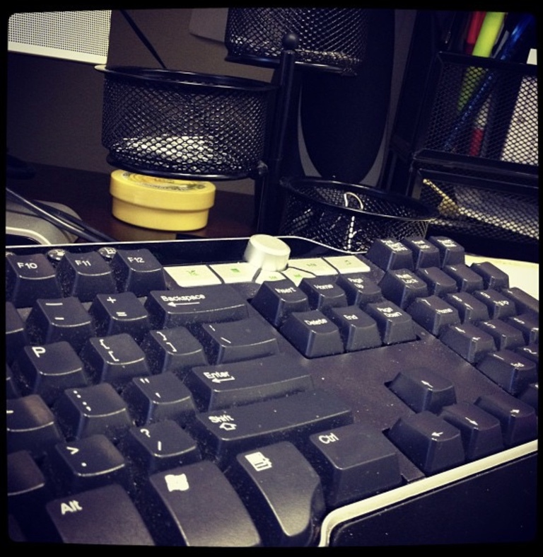 A computer keyboard on a desk